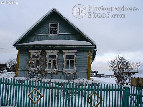 Typical Russian Rural House In Winter