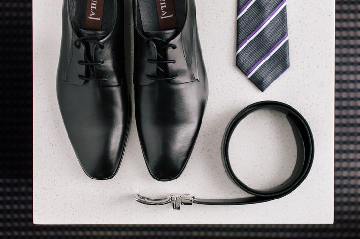 The Groom's getting ready details. Shoes, tie and belt all in one photo. Photos by Hilary Cam Photography