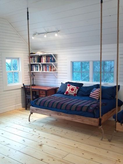 This suspended bed is attached to the wall with hinges — you can remove the ropes and fold the bed against the wall.