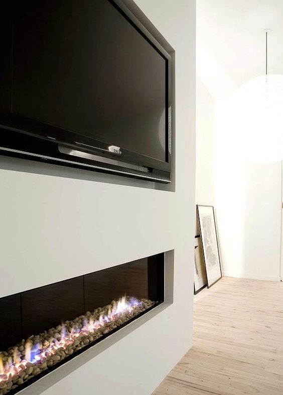 Recessed tv and fireplace.: