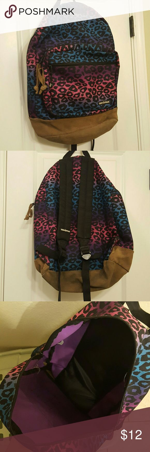 Rainbow Animal Print Backpack Durable backpack with lots of space. 2 front pockets are very deep, providing plenty of extra room for smaller items. All but 2 zippers have a suede tie that matches the bottom of the backpack - one zipper on the main part of the backpack lost its tie & the zipper on the smallest pocket has pull of the company logo that manufactured the backpack.   In extremely good condition, no holes & all zippers function properly & easily as they should. Selling only because…