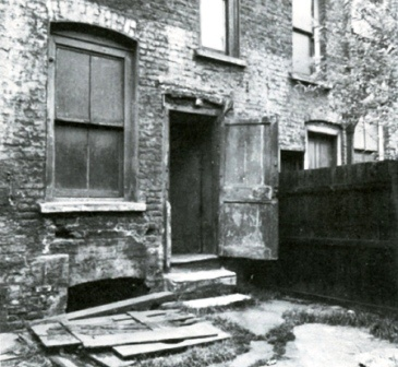 The backyard at 29 Hanbury Street, murder site of Annie Chapman. Her body was found between the steps down from the back door and the fence.