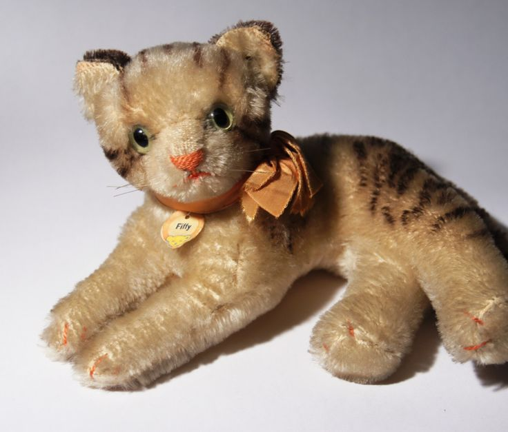 Rare Steiff Cat Fiffy - Silver Button & Chest Tag - Original Ribbon - 1955-1962 - Medium 17cm 7inches by LuckyPatina on Etsy https://www.etsy.com/listing/197636599/rare-steiff-cat-fiffy-silver-button