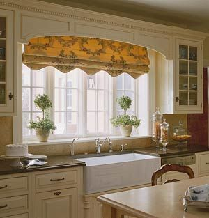 Large kitchen windows over sink. Webpage shows huge variety of countertop surfaces and kitchen arrangements.