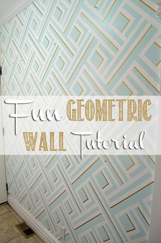 Fun Geometric Wall Tutorial on http://hertoolbelt.com   Seriously this design was made with paint and Frog Tape, so easy.