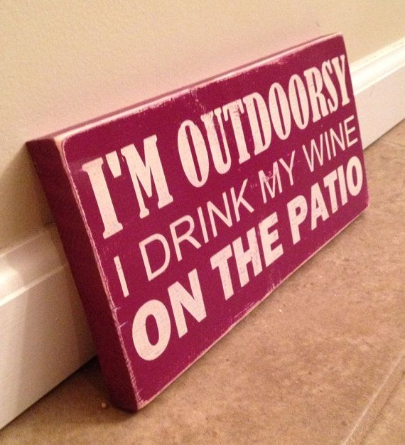 I'm outdoorsy wine sign  - wood wall art.  I'd have to change the word patio to balcony