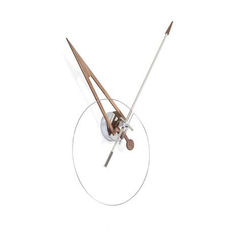 Like an arrow through the heart, Cris Walnut combines two simple ingredients to complete this minimalistic vision, wood and steel. The perfect wall piece for any modern home, while understated in color, the sharp and forward features of the clock are what truly makes it striking. While purposeful, this piece of artwork collectively exudes the designers Spanish flare to any setting.