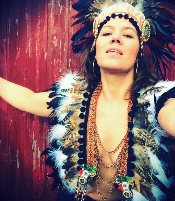 Tribal natural feather breastplate. Burning Man style. Shop look at www.wildthing.com and https://www.etsy.com/uk/shop/feathersandthreaduk