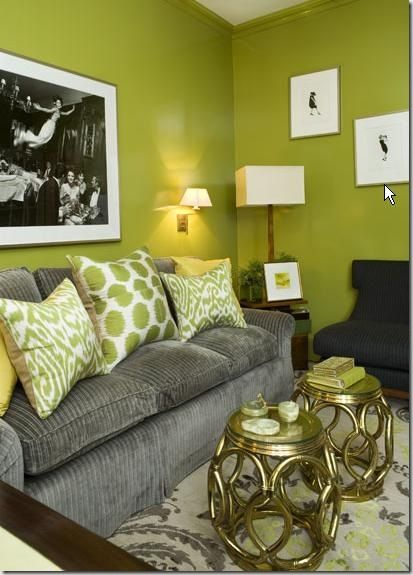 Lovely living room. Love the green on the walls and cushions and the grey sofa!
