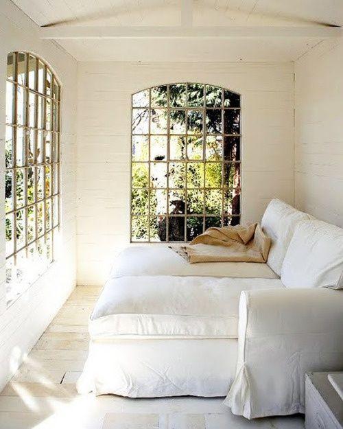 Sunroom =  huge windows + white linen chaises