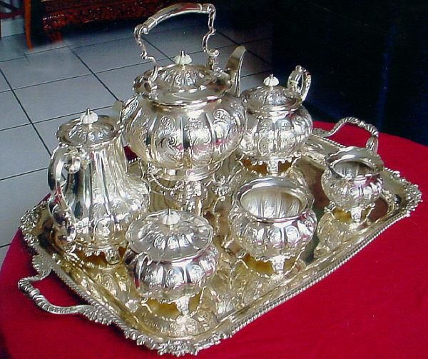 "Sheffield silver plated tea service with tray, this ""Sheffield tea service"" is made with a sterling silver plate along with its tray. Excellent condition. This ""Sheffield' tea set dates from the 1950 period. the tray is 29 inches from handle to handle."