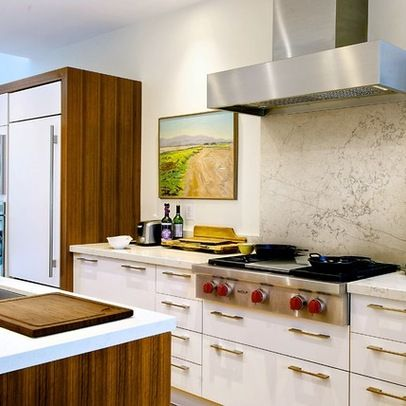 """Countertop & Backsplash are: Marble - Bianco Asiago antique finish (you can feel the veins).""""  Wood is walnut veneer.  Floor is oak. (And incidentally, the cooktop is Wolf. :)  Note: large backsplash slab like this easier to clean than something with grout."""
