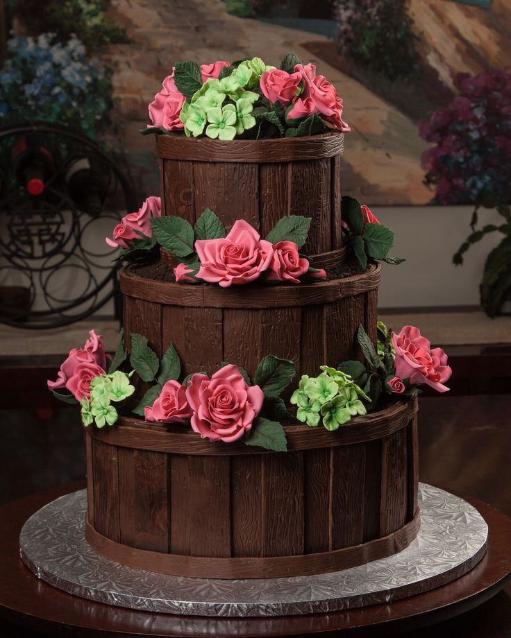 gumpaste flowers and modeling chocolate. 6, 9, 12 inch tiers.