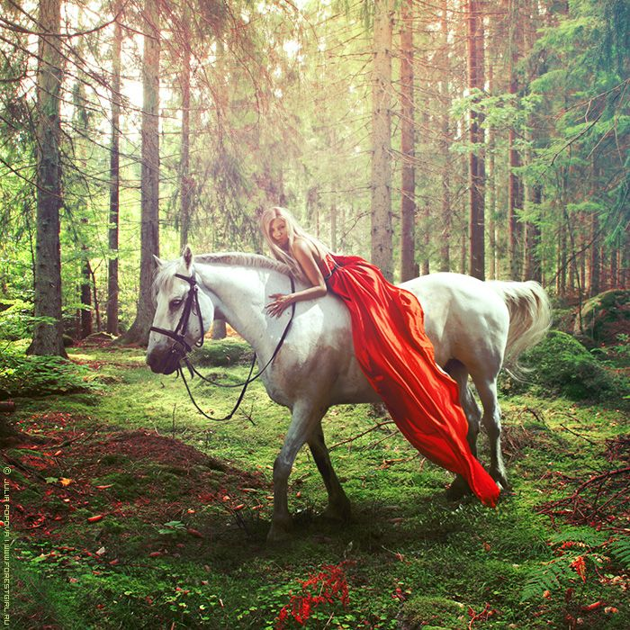 Woman with stunning red dress and horse in forest