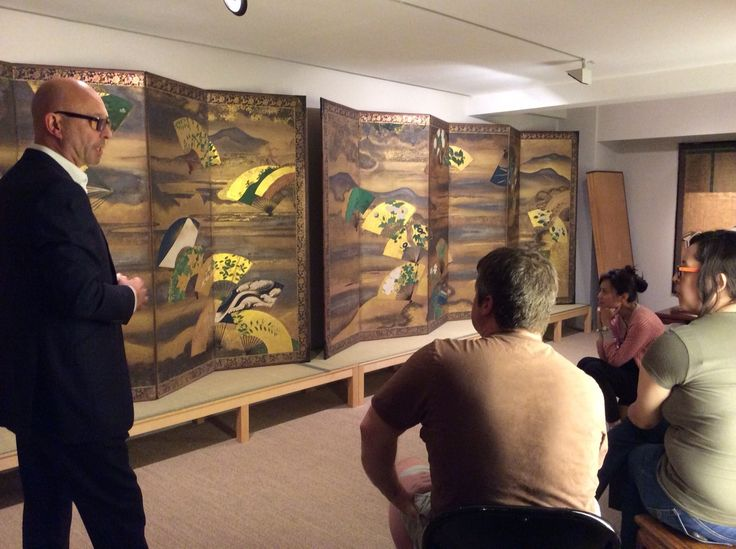 SOAS lecture in the gallery. July 2014. In the background: A pair of six-fold semmen nagashi-zu byōbu (screens with fans over flowing water). School of Tawaraya Sōtatsu (died ca.1640) Japan 17th century Edo period