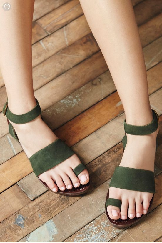 Essential flat sandal featuring a suede design with over-the-foot closures. Adjustable strap wraps effortlessly around the ankle. Modern and sartorial styles, artisan crafted from fine leathers and premium materials, FP Collection shoes are coveted for their signature cutting-edge aesthetic