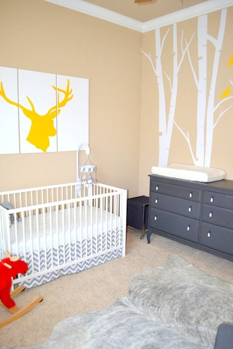 Love the grey chevron crib skirt. Truly love the painting above the crib. My hubby would do go for this kind of decor.