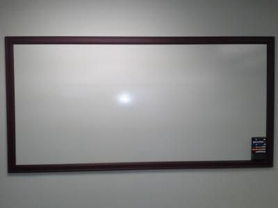 DIY Whiteboard. White panel board ($10) and some prestained trim (~20). Total is $30 for an 8'x4' whiteboard!!! Huge savings, works great!