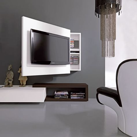 TV Rack cleverly combines media storage and a rotating TV stand into one sleek unit. The composition can be customized in a variety of sizes and finishes. Resource Furniture