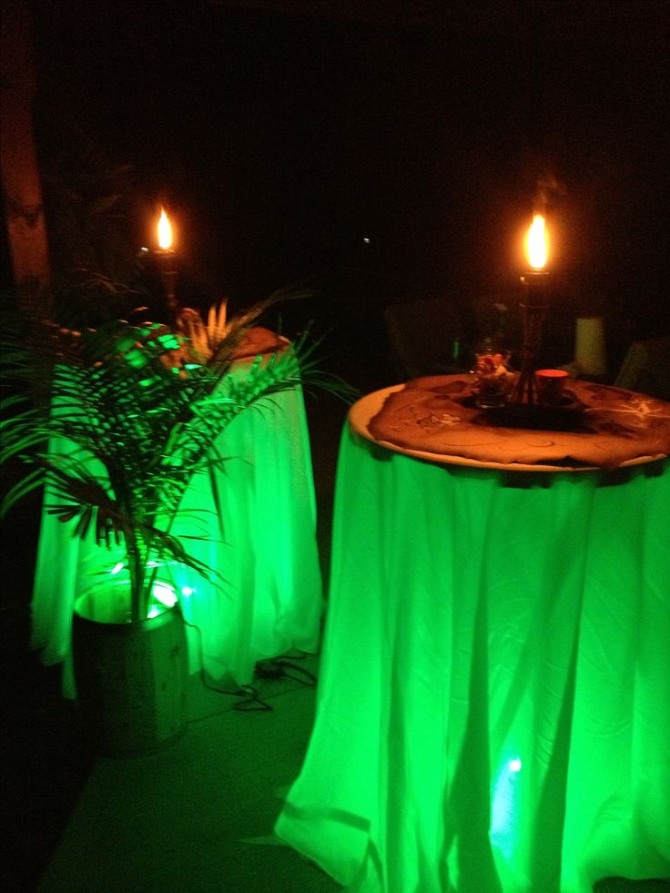 Underlit tables for a luau party! #luau #tableideas #weddingtables
