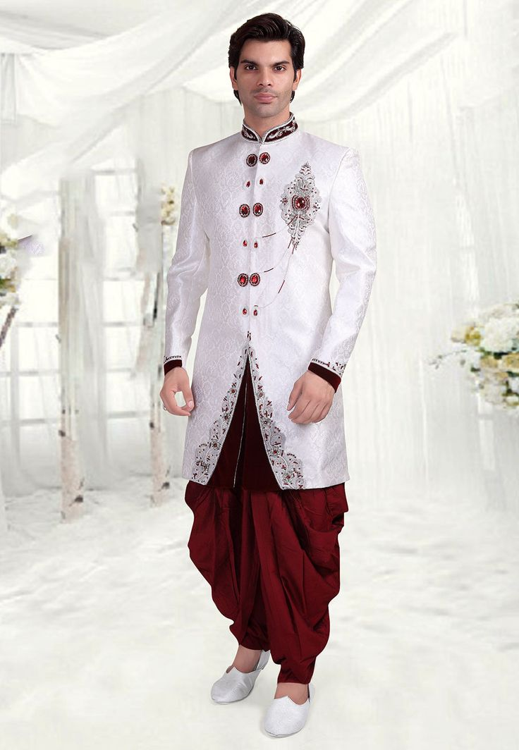 Readymade Hand Embroidered Art Brocade Silk Sherwani in White Finely detailed with Buttons, Beads, Applique, Zari and Stone Work Available with a Maroon Art Silk Dhoti Pant Do note: Footwear shown in the image is for presentation purposes only. Half to one inch may vary in measurement. (Slight variation in actual color vs. image is possible)