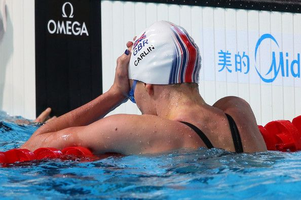 Jazmin Carlin of Great Britain shows her dejection after narrowly missing a bronze medal placing in the Swimming Women's400mFreestyle Final on day nine of the 15th FINA World Championships at Palau Sant Jordi on July 28, 2013 in Barcelona, Spain.