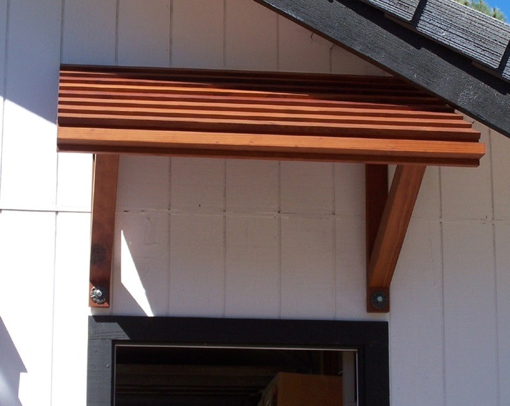 a wood awning may be an alternative to fabric if the ...