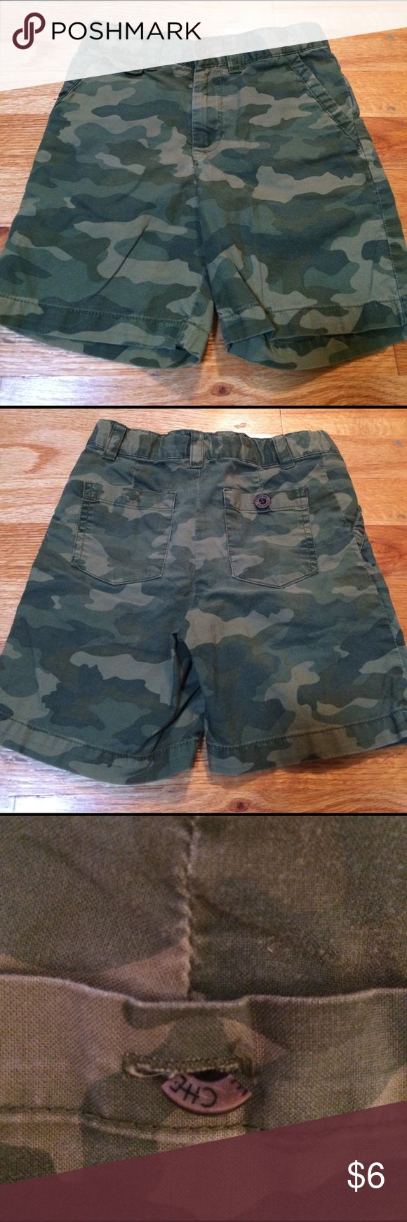 Cherokee camouflage shorts, size 4T. Cherokee camouflage shorts.  Button broken on back pocket (see pic).  Size 4T. Cherokee Bottoms Shorts