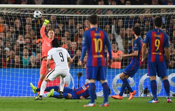 Edinson Cavani of Edinson Cavani of PSG (9) scores their first goal past goalkeeper Marc-Andre ter Stegen of Barcelona during the UEFA Champions League Round of 16 second leg match between FC Barcelona and Paris Saint-Germain at Camp Nou on March 8, 2017 in Barcelona, Catalonia.