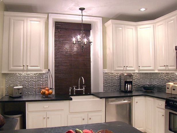 Silver backsplash black countertops white cabinets dream home pinterest black counters - White kitchen dark counters ...