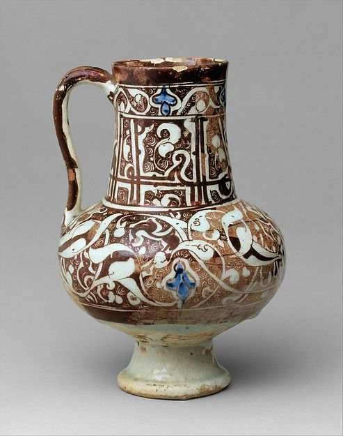 Ewer Date: late 12th–first half 13th century Geography: Syria, Raqqa Culture: Islamic Medium: Stonepaste; underglaze painted in blue, luster-painted on transparent glaze