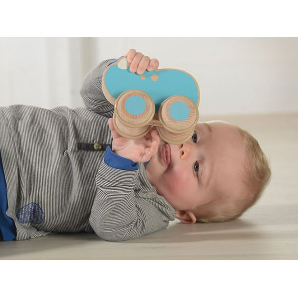 Adorable Rhino-shaped push along toy made of FSC certified European beech. A perfect toy for baby who starts to grasp, hold and push objects.