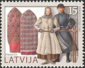 Latvia, 2004. Part of a series of stamps that were issued between 2002 and 2005, and each bears both mittens and costumes from a different region of the Latvia.