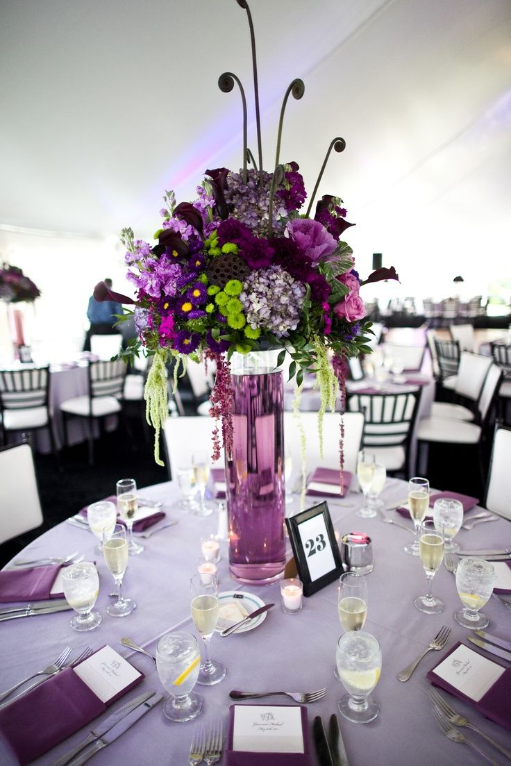 Wedding Decoration, : Awesome Dining Table Decor Ideas With Tall Purple Flowers On Purple Glass Vase Combine With Round Table Plus White Table Sheet And White Black Chairs