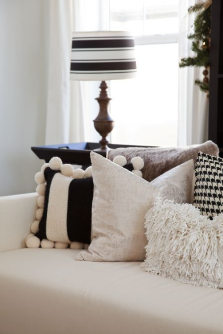 Striped pom pom pillow.