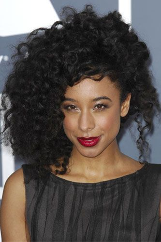 """Curl Story: Flaunt Your Coils With These Cool Party 'Dos #refinery29 http://www.refinery29.com/41159#slide6 We're obsessed with Corinne Bailey Rae's gorgeous, windswept curls here, and Dickey totally agrees: """"Holiday hair, to me, means bigger and more festive! Enhance your natural texture by really showing it off. First, apply Hair Rules Curly Whip to very wet curls, then blow them dry with a diffuser. This will set curls while giving you lots of volume."""" """"After diffusing, flip head over ..."""