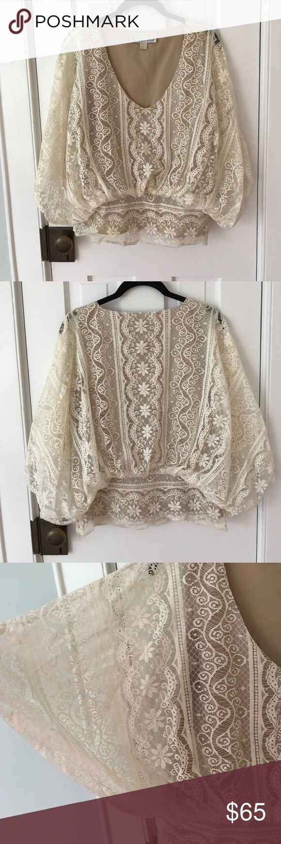 Beyond Vintage Ivory Lace Top Beautiful ivory lace top by Beyond Vintage. Dolman / batwing sleeves. Nude tank lining. Purchased at Shopbop; was also a best seller at Anthropologie and Free People. This top always gets tons of compliments. Perfect condition except for one small, easily removable stain - pictured.   Let me know if you have any questions or an offer! Beyond Vintage Tops