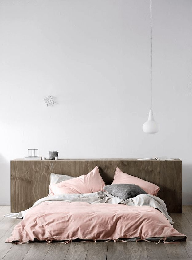 white bedroom with dusty rose bedding gray
