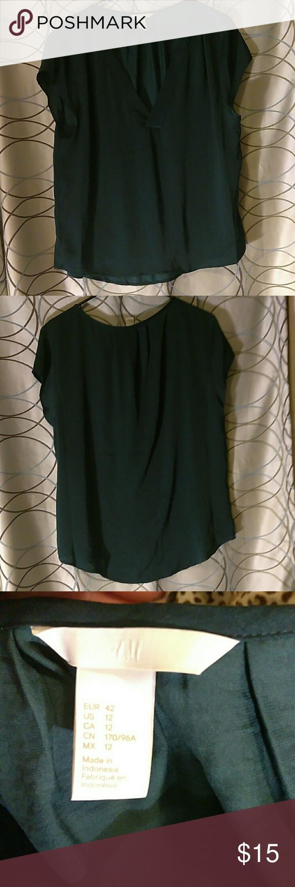 H&M Hunter Green Short Sleeve Top 100% polyester v-neck short sleeve top. Worn once. In excellent condition. Can wear with a pair of jeans or dress up. Light weight and comfortable. H&M Tops Blouses