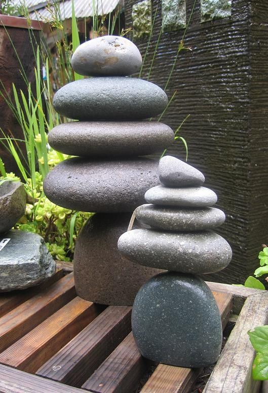 Cairn - Stacked rock cairns in various sizes add a Zen element to the garden or home.  These rock sculptures are symbolically used by cultures throughout the world to mean various things – from a memorial marker to a spiritual temple.