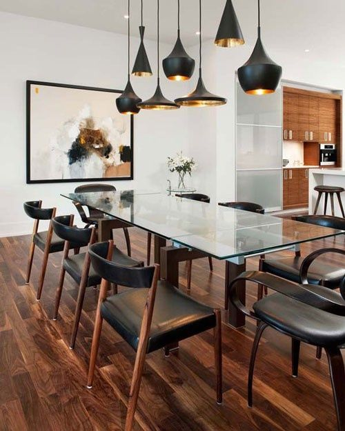 """""""Masculine kitchen and dining room"""" and check out the modern light fittings over the dining room table."""