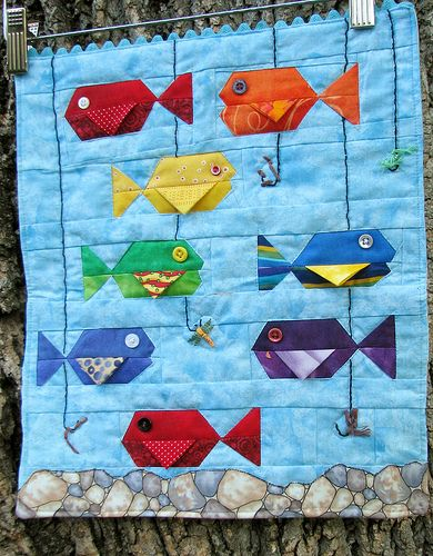 FISH QUILT: The fins made me smile! (If I were making this for a baby,  I wouldn't use buttons.)