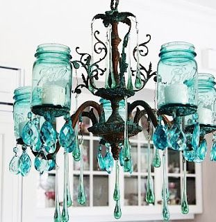 Find an old non-working chandelier at a thrift store, add mason jars, and hanging crystals then voila! A country chic candelabra!