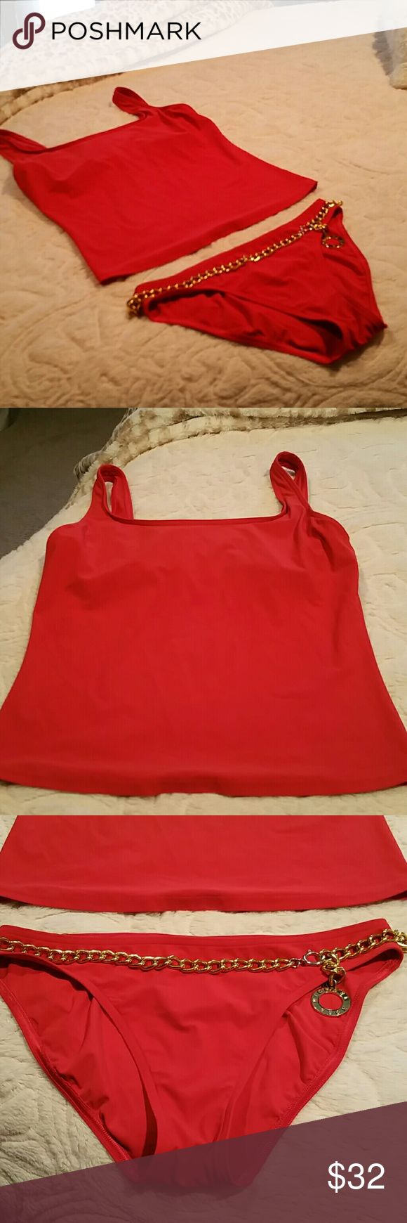 Michael Kors Red Tankini Size 6 Reposhing- tried and tried to get this to work for me but I have just too much fluff around my middle. Such a cute suit and in great condition!! Light padding in top- built in shelf for more coverage up top. Color is red even though looks a bit orange in pics. Comes from smoke and pet free home. Bundle to save more $$! Michael Kors Swim Bikinis