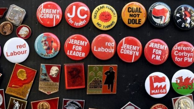 Badges promoting British opposition Labour party Leader Jeremy Corbyn are pictured on the third day of annual Labour Party conference in Liverpool, north west England on September 27, 2016