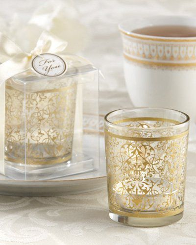 Add a golden touch to your special day with these golden renaissance glass tea light holder. Tea light holder has a bright metallic baroque inspired design to sit perfectly alongside your centerpieces.