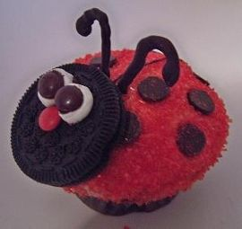 This Love Bug is an iced cupcake rolled in red sugar crystals, an Oreo, mini marshmallow cut in two, mini red M&M for the nose, melted chocolate piped on a sheet to shape the antennae, chocolate chips for the body...made them for my grandson's first-grade Valentine's party but used pretzel sticks for antennae to transport better.