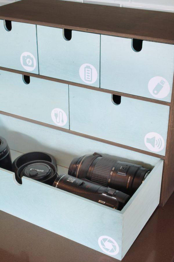 Are you drowning in cords and cables, and always searching for the right camera lens? Use an IKEA Moppe with custom cut icon labels to get organized in the kitchen, entry, or office!
