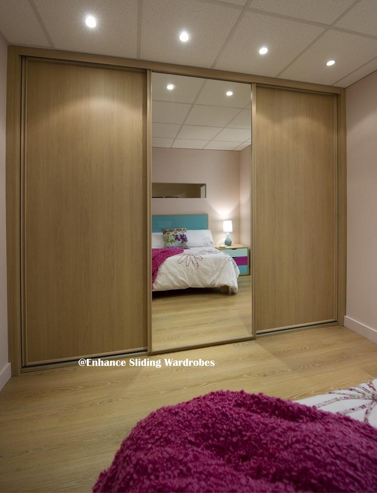 Oak and mirror sliding wardrobe #bedroom #wardrobe #storage // Designed by Enhance Sliding Wardrobes www.enhanceslidingwardrobes.com