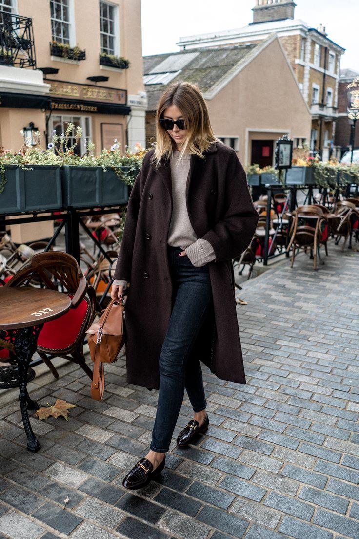 Emma Hill style, Brown winter coat, washed black skinny jeans, beige wool jumper, Loewe puzzle bag, oversized Celine sunglasses, mock croc brown loafe…